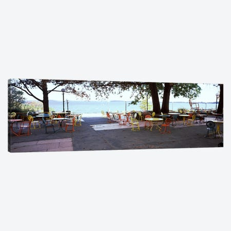 Empty chairs with tables in a campus, University of Wisconsin, Madison, Dane County, Wisconsin, USA Canvas Print #PIM7191} by Panoramic Images Canvas Print