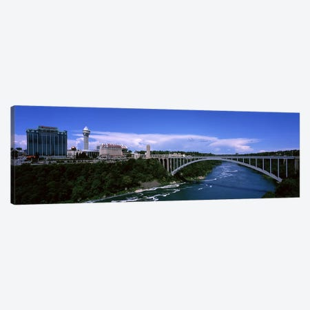 Bridge across a riverRainbow Bridge, Niagara River, Niagara Falls, New York State, USA Canvas Print #PIM7222} by Panoramic Images Canvas Art Print