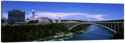 Bridge across a riverRainbow Bridge, Niagara River, Niagara Falls, New York State, USA Canvas Print #PIM7222