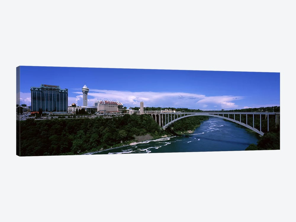 Bridge across a riverRainbow Bridge, Niagara River, Niagara Falls, New York State, USA by Panoramic Images 1-piece Art Print