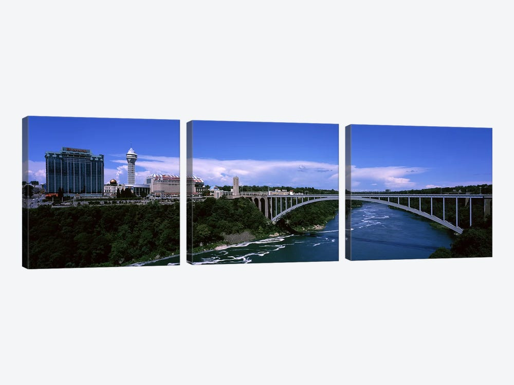Bridge across a riverRainbow Bridge, Niagara River, Niagara Falls, New York State, USA by Panoramic Images 3-piece Canvas Print