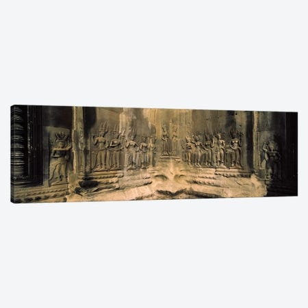 Bas relief in a temple, Angkor Wat, Angkor, Cambodia Canvas Print #PIM7327} by Panoramic Images Canvas Art Print