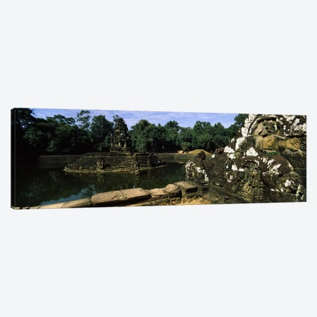 Statues in a temple, Neak Pean, Angkor, Cambodia Canvas Print #PIM7330} by Panoramic Images Canvas Art Print