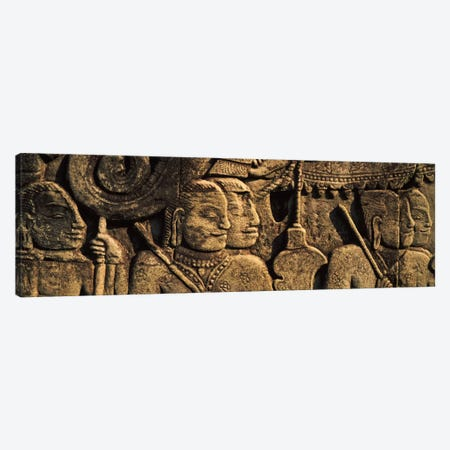 Sculptures in a temple, Bayon Temple, Angkor, Cambodia Canvas Print #PIM7335} by Panoramic Images Canvas Wall Art