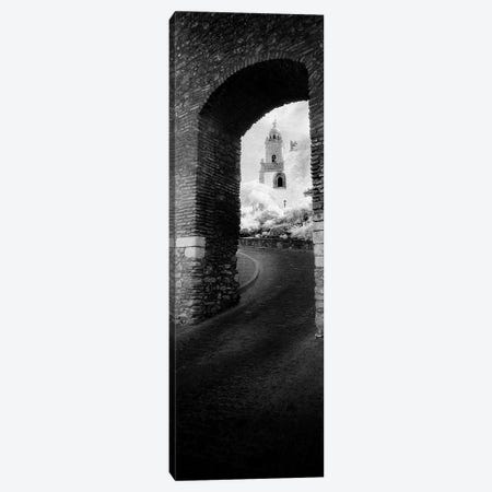 Church viewed through an archway, Puerta Del Sol, Medina Sidonia, Cadiz, Andalusia, Spain Canvas Print #PIM7338} by Panoramic Images Art Print