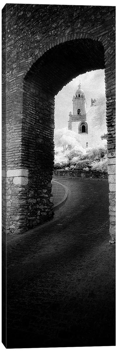 Church viewed through an archway, Puerta Del Sol, Medina Sidonia, Cadiz, Andalusia, Spain Canvas Art Print