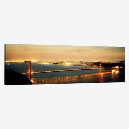Suspension bridge lit up at dusk, Golden Gate Bridge, San Francisco Bay, San Francisco, California, USA Canvas Print #PIM7364} by Panoramic Images Art Print