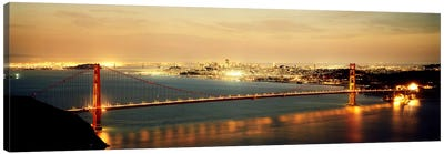 Suspension bridge lit up at dusk, Golden Gate Bridge, San Francisco Bay, San Francisco, California, USA Canvas Print #PIM7364