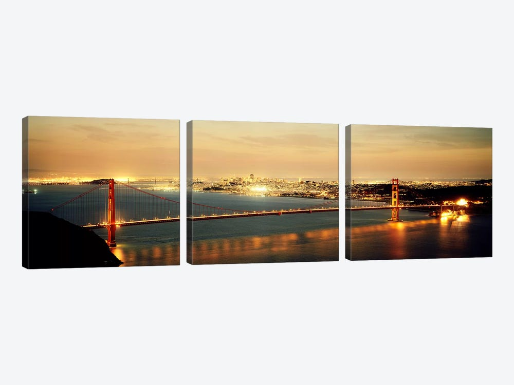 Suspension bridge lit up at dusk, Golden Gate Bridge, San Francisco Bay, San Francisco, California, USA by Panoramic Images 3-piece Canvas Wall Art