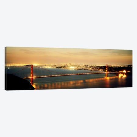Suspension bridge lit up at dusk, Golden Gate Bridge, San Francisco Bay, San Francisco, California, USA Canvas Print #PIM7364} by Panoramic Images Art Print