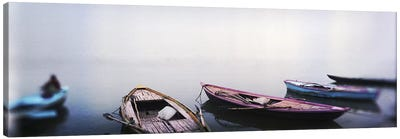 Row boats in a riverGanges River, Varanasi, Uttar Pradesh, India Canvas Print #PIM7402