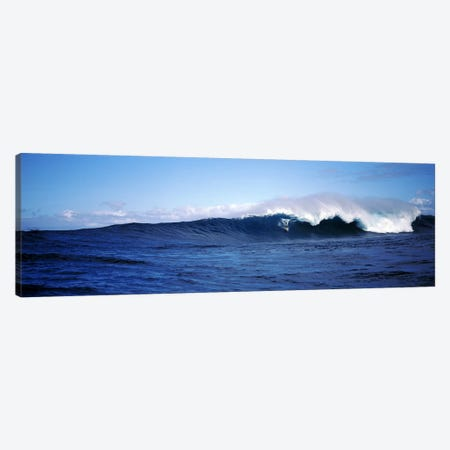 Distant View Of A Surfer On A Cresting Ocean Wave Canvas Print #PIM7417} by Panoramic Images Art Print