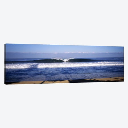 Distant View Of A Lone Surfer On A Cresting Wave, North Shore, Oahu, Hawaii, USA Canvas Print #PIM7423} by Panoramic Images Art Print