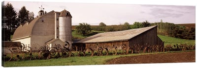 Old barn with a fence made of wheels, Palouse, Whitman County, Washington State, USA Canvas Art Print