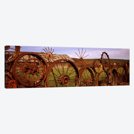 Old barn with a fence made of wheels, Palouse, Whitman County, Washington State, USA #2 Canvas Print #PIM7529} by Panoramic Images Canvas Artwork