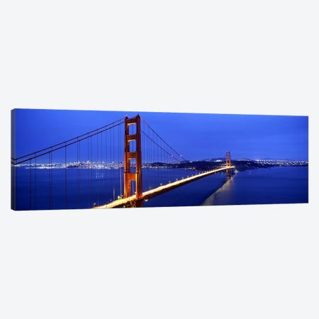 Suspension bridge lit up at duskGolden Gate Bridge, San Francisco, California, USA Canvas Print #PIM7573} by Panoramic Images Canvas Print