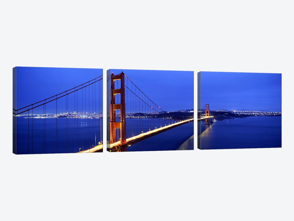 Suspension bridge lit up at duskGolden Gate Bridge, San Francisco, California, USA by Panoramic Images 3-piece Canvas Art