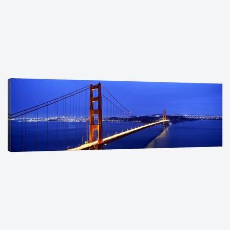 Suspension bridge lit up at duskGolden Gate Bridge, San Francisco, California, USA Canvas Print #PIM7573} by Panoramic Images Canvas Print