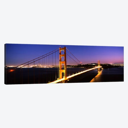 Suspension bridge lit up at dusk, Golden Gate Bridge, San Francisco, California, USA Canvas Print #PIM7578} by Panoramic Images Art Print