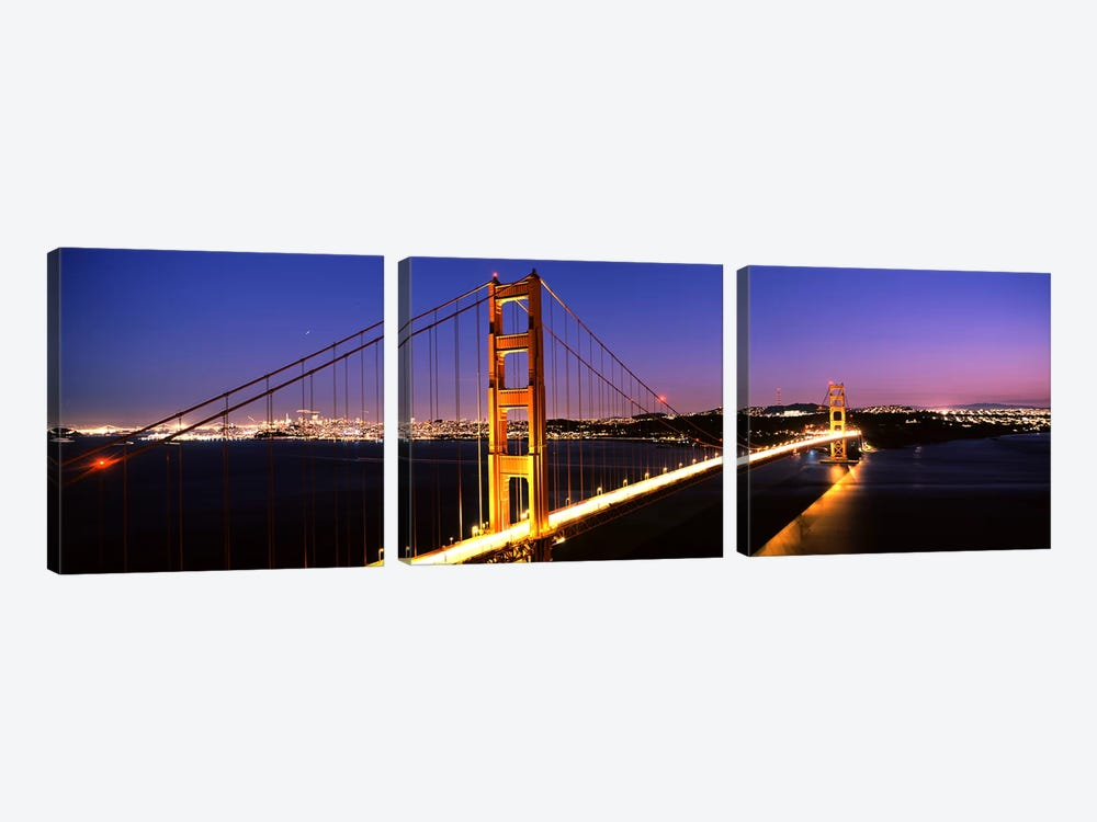 Suspension bridge lit up at dusk, Golden Gate Bridge, San Francisco, California, USA by Panoramic Images 3-piece Canvas Print