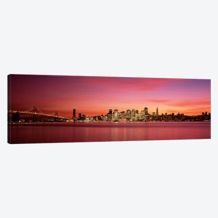 Suspension bridge with city skyline at duskBay Bridge, San Francisco Bay, San Francisco, California, USA Canvas Print #PIM7596} by Panoramic Images Canvas Art