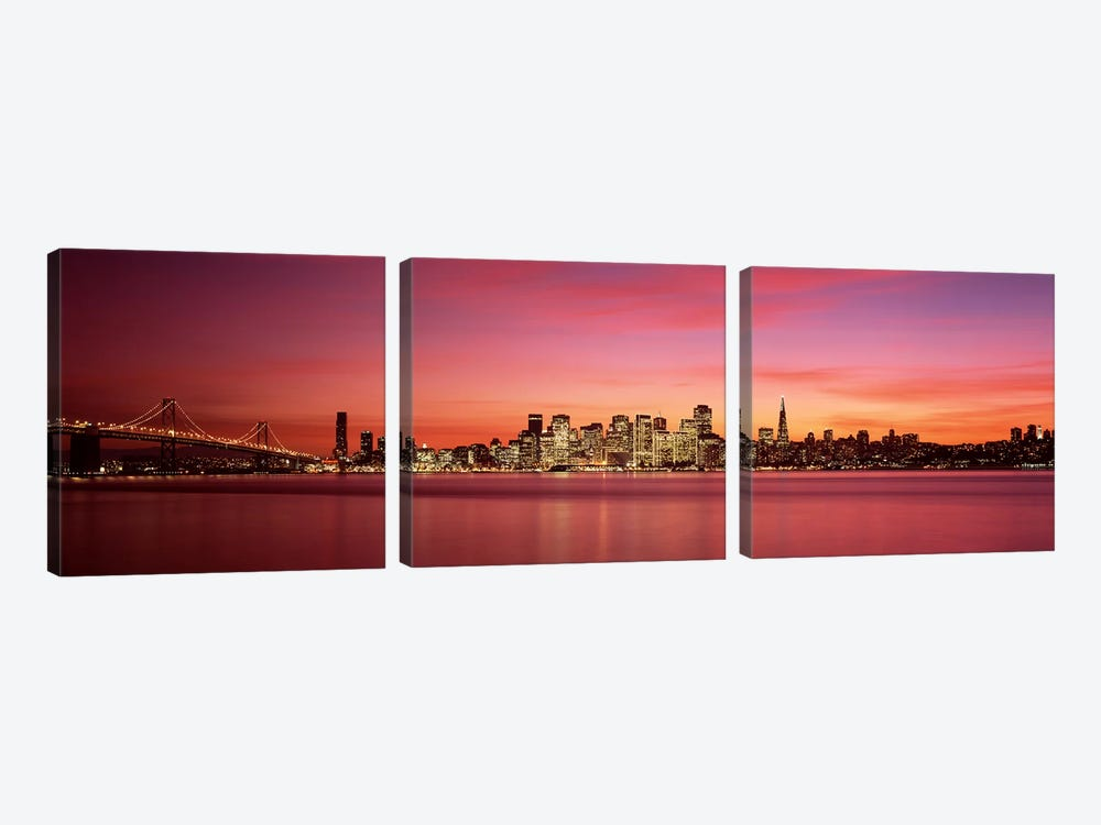 Suspension bridge with city skyline at duskBay Bridge, San Francisco Bay, San Francisco, California, USA by Panoramic Images 3-piece Art Print