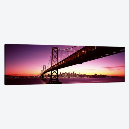 Bridge across a bay with city skyline in the background, Bay Bridge, San Francisco Bay, San Francisco, California, USA Canvas Print #PIM7597} by Panoramic Images Canvas Artwork