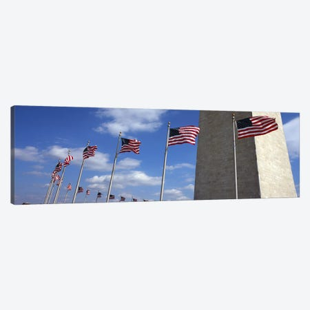 American Flags Flapping In The Wind, Washington Monument, National Mall, Washington, D.C., USA Canvas Print #PIM7651} by Panoramic Images Canvas Artwork