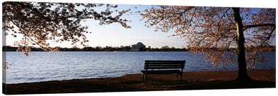Park bench with a memorial in the background, Jefferson Memorial, Tidal Basin, Potomac River, Washington DC, USA Canvas Art Print
