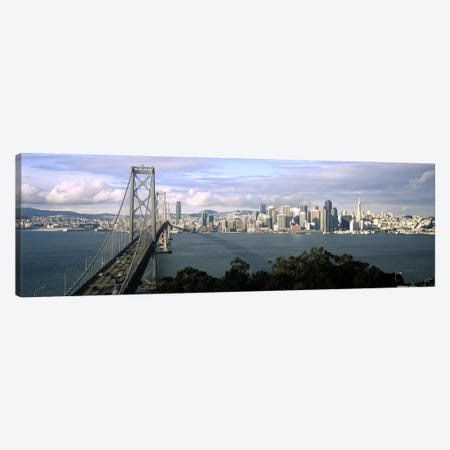 Bridge across a bay with city skyline in the background, Bay Bridge, San Francisco Bay, San Francisco, California, USA #3 Canvas Print #PIM7839} by Panoramic Images Canvas Wall Art