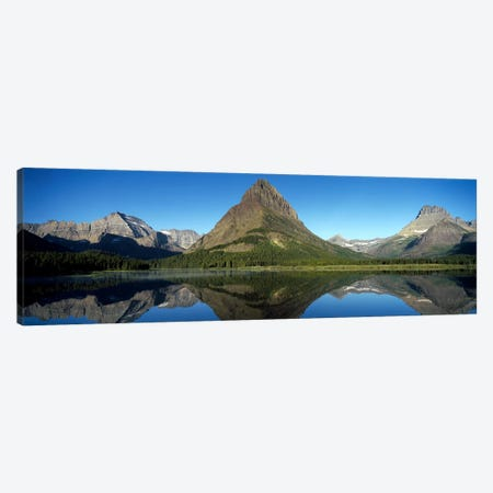 Mount Wilbur And Its Reflection In Swiftcurrent Lake, Many Glacier Region, Glacier National Park, Montana, USA Canvas Print #PIM7878} by Panoramic Images Canvas Artwork