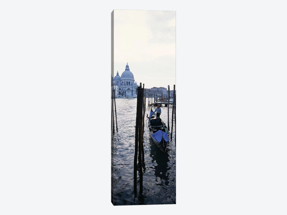 Gondolier in a gondola with a cathedral in the background, Santa Maria Della Salute, Venice, Veneto, Italy by Panoramic Images 1-piece Canvas Wall Art