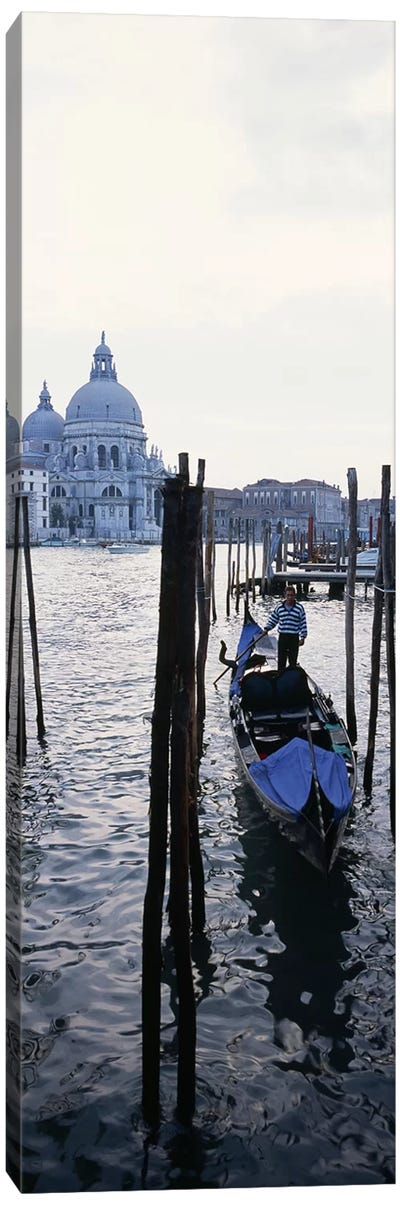 Gondolier in a gondola with a cathedral in the background, Santa Maria Della Salute, Venice, Veneto, Italy Canvas Art Print