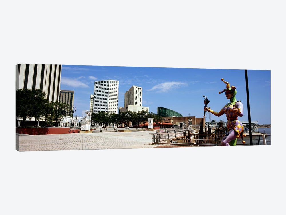 Jester statue with buildings in the background, Riverwalk Area, New Orleans, Louisiana, USA by Panoramic Images 1-piece Canvas Print