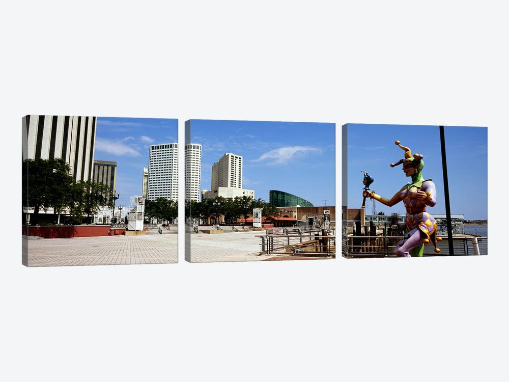 Jester statue with buildings in the background, Riverwalk Area, New Orleans, Louisiana, USA by Panoramic Images 3-piece Canvas Art Print