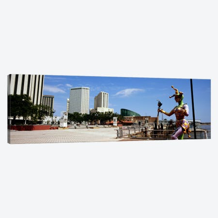 Jester statue with buildings in the background, Riverwalk Area, New Orleans, Louisiana, USA Canvas Print #PIM7897} by Panoramic Images Art Print