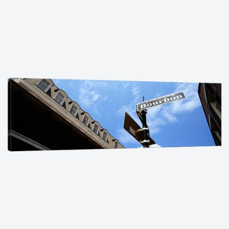 Street name signboard on a pole, Bourbon Street, French Market, French Quarter, New Orleans, Louisiana, USA Canvas Print #PIM7901} by Panoramic Images Canvas Wall Art