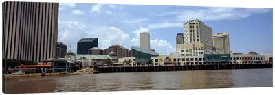 Buildings viewed from the deck of a ferry, New Orleans, Louisiana, USA Canvas Art Print