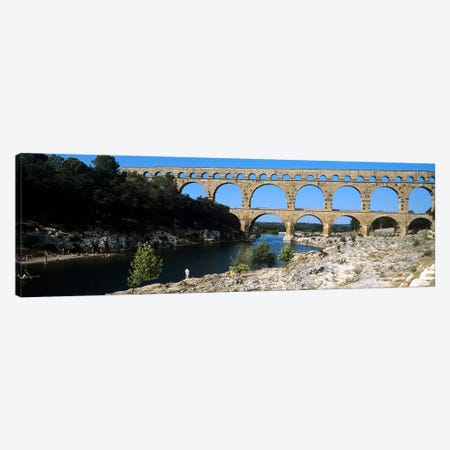 Aqueduct across a river, Pont Du Gard, Nimes, Gard, Languedoc-Rousillon, France Canvas Print #PIM7939} by Panoramic Images Art Print
