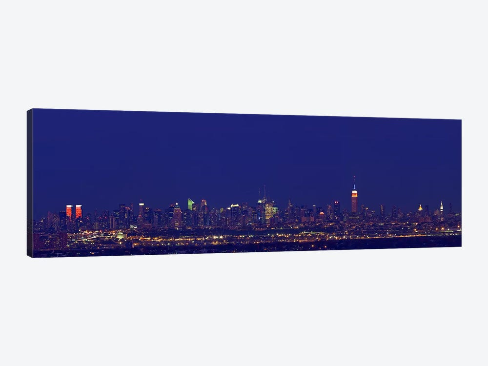 Buildings in a city lit up at night, New York City, New York State, USA by Panoramic Images 1-piece Art Print