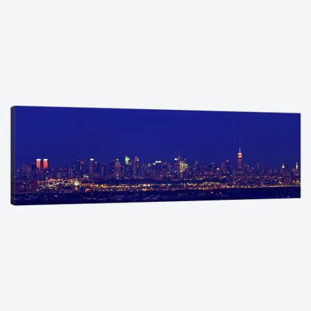 Buildings in a city lit up at night, Upper Manhattan, Manhattan, New York City, New York State, USA Canvas Print #PIM7999} by Panoramic Images Art Print