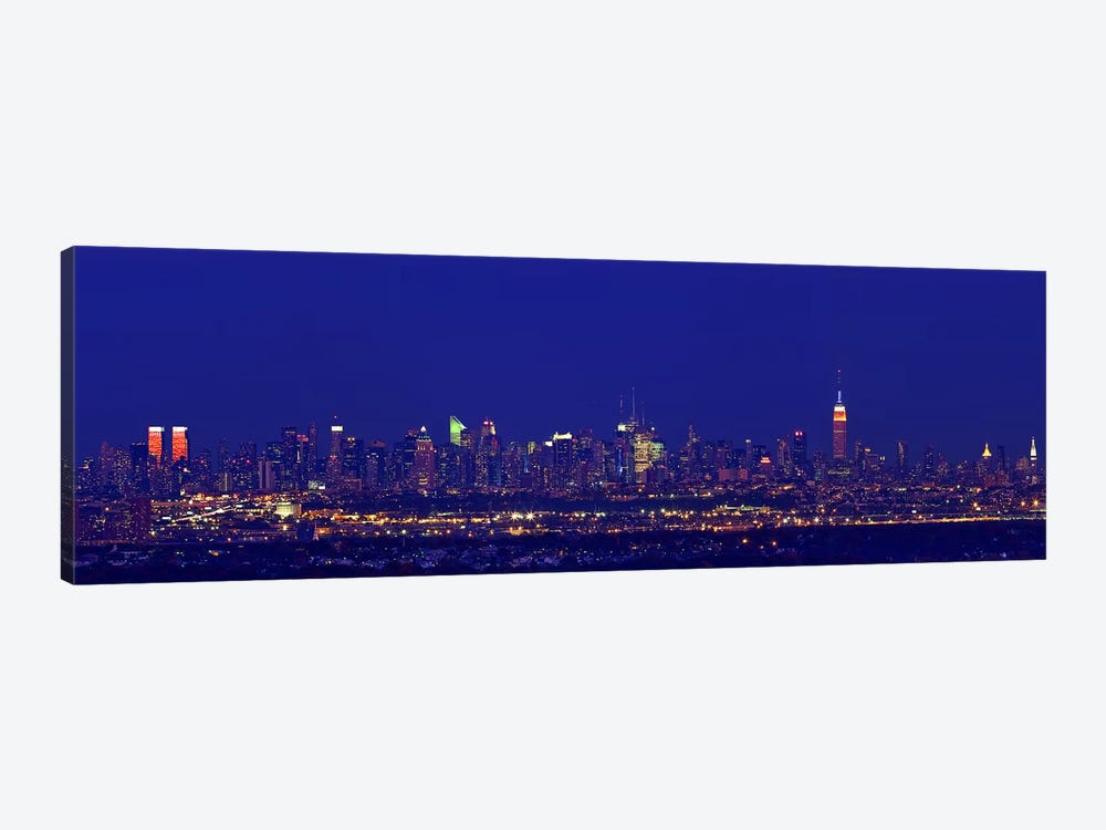 Buildings in a city lit up at night, Upper Manhattan, Manhattan, New York City, New York State, USA by Panoramic Images 1-piece Canvas Artwork