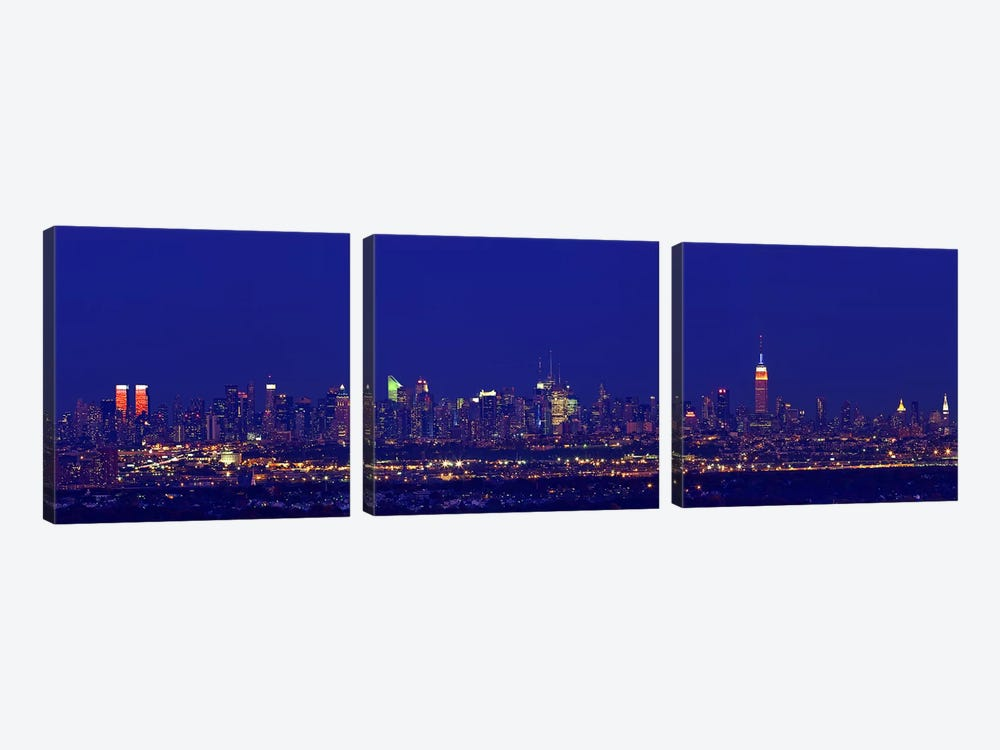 Buildings in a city lit up at night, Upper Manhattan, Manhattan, New York City, New York State, USA by Panoramic Images 3-piece Canvas Art