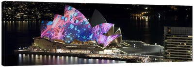 Opera house lit up at night, Sydney Opera House, Sydney, New South Wales, Australia Canvas Print #PIM8007