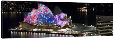Opera house lit up at night, Sydney Opera House, Sydney, New South Wales, Australia Canvas Print #PIM8007