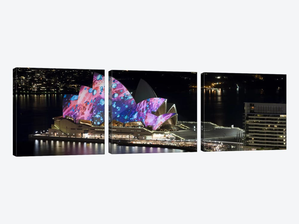 Opera house lit up at night, Sydney Opera House, Sydney, New South Wales, Australia by Panoramic Images 3-piece Canvas Art