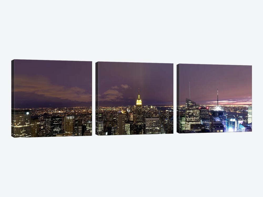 Buildings in a city lit up at dusk, Midtown Manhattan, Manhattan, New York City, New York State, USA by Panoramic Images 3-piece Art Print