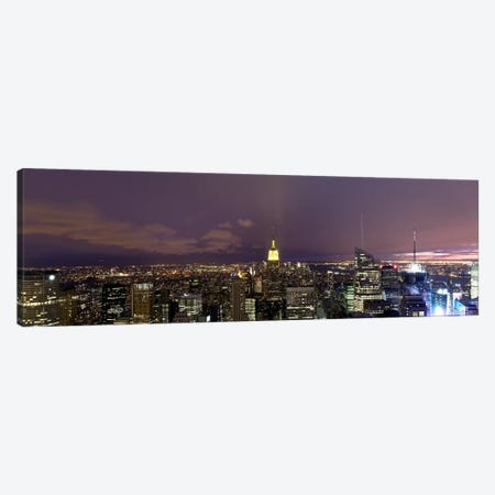 Buildings in a city lit up at dusk, Midtown Manhattan, Manhattan, New York City, New York State, USA Canvas Print #PIM8017} by Panoramic Images Canvas Art Print