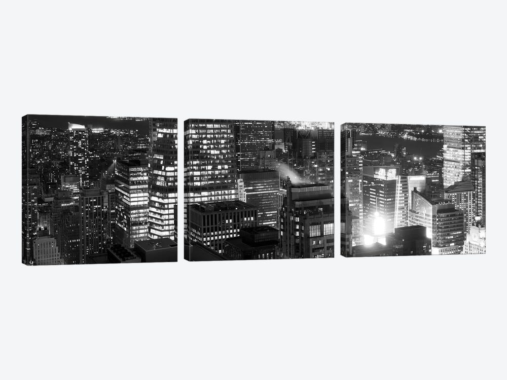 Aerial view of a city at night, Midtown Manhattan, Manhattan, New York City, New York State, USA by Panoramic Images 3-piece Art Print