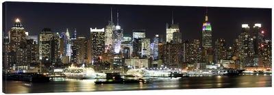 Buildings in a city lit up at night, Hudson River, Midtown Manhattan, Manhattan, New York City, New York State, USA Canvas Art Print